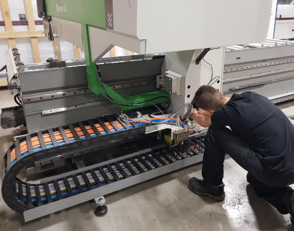 A photo of an R&J Machinery engineer servicing a Biesse machine