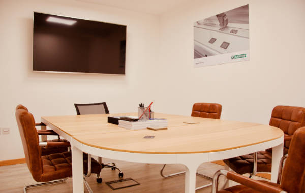 A photograph of R&J Machinery's meeting room