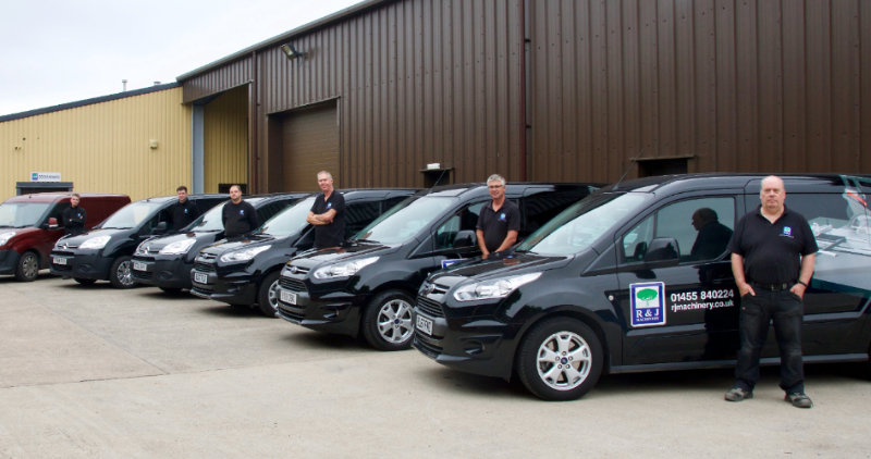 A photograph of the R&J Machinery engineering team alongside their vans